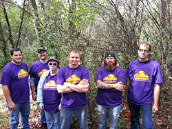 Volunteers from Black Cat Blades posing with their Trail Crew shirts